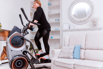 woman on elliptical trainer